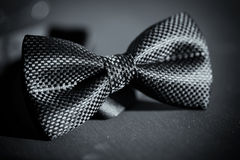 Close-up photo of black bow tie on dark background royalty free stock images