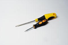Close-up photo of black and yellow screwdrivers on the white bac Royalty Free Stock Photography