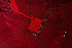 Close up photo of red pcb. Close up photo of blue printecd circuit board with solder points Royalty Free Stock Images