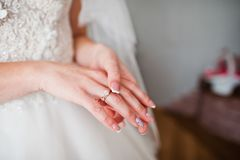 Close-up photo of bride`s finger with ring on it. Royalty Free Stock Image