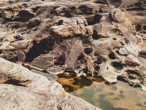 Close-up Photo of Brown rocks Beside Body of Water Stock Photo