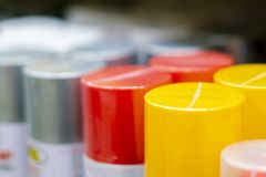 Close up photo of bunch of spray multicolored paint cans on shelf b royalty free stock image