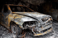 Close up photo of a burned out car Stock Photos
