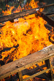 Close-up photo of burning wooden boxes. In big bonfire Stock Photo