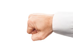 Close-up photo of a businessman fist isolated on white. Background Royalty Free Stock Images