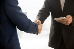 Close up photo of IT businessmen shaking hands Royalty Free Stock Images