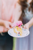 Close-up photo of cake decorated with pink flowers outdoors Royalty Free Stock Photos