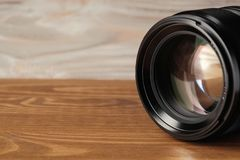 Close up photo of camera lens on wood. Lens for camera. royalty free stock photography