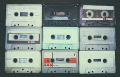 Close up photo of cassette tape over wooden table . top view. retro filtered.  royalty free stock photos