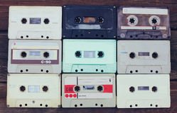 Close up photo of cassette tape over wooden table . top view. retro filtered Stock Image