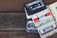 Close up photo of cassette tape over wooden table . top view. retro filtered Stock Photo