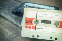 Close up photo of cassette tape over wooden table . top view. retro filtered Stock Images