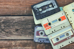 Close up photo of cassette tape over wooden table . top view. retro filtered Royalty Free Stock Photography