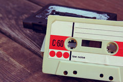Close up photo of cassette tape over wooden table . top view. retro filtered Stock Photography