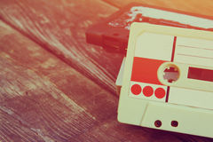 Close up photo of cassette tape over wooden table . top view. retro filtered Royalty Free Stock Image