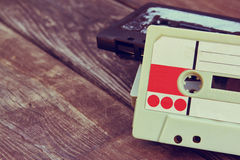 Close up photo of cassette tape over wooden table . top view. retro filtered Royalty Free Stock Photo