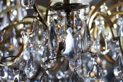 Close-up photo of chandelier during Jason Wu show. NEW YORK, NY - FEBRUARY 10: Close-up photo of chandelier during Jason Wu show during New York Fashion Week on royalty free stock image