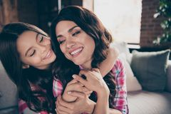 Close up photo cheer two people cuddle mum little daughter satisfied piggy-back hold adorable look eyes wear pink plaid. Shirts flat apartment room comfortable royalty free stock photo