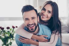 Close up photo of cheerful excited glad careless happy with toot. Hy beaming smile brunette attractive women and with stylish hairdo man, she is hugging him from Stock Image