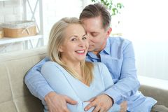 Close up photo of cheerful excited happy happily happy with toothy shining smile blond attractive woman and man, he hugs Royalty Free Stock Photo