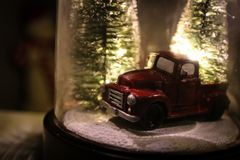Christmas Snow Globe With Winter Trees & Vintage Truck stock photos