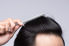 Close up photo of clean healthy man`s hair. Young man comb his h. Air Stock Image