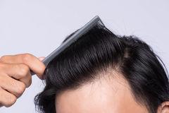 Close up photo of clean healthy man`s hair. Young man comb his h Royalty Free Stock Images