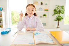 Close up photo of clever genius little small lady raise hands have knowledge sit class room reaction dressed white stock photos