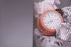 Close-up photo of a clock in refuse bin with other Royalty Free Stock Photography