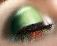 Close up photo of closed woman eye with green makeup Stock Photography