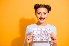 Close up photo cute beautiful she her lady pretty hairdo two buns hand arm hold paper calendar marked days off vacation. Weekend wear casual white pullover royalty free stock photo