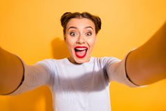 Close up photo of cute funny cheerful shocked childish lady taking photos impressed by incredible news with positive. Mood has her mouth open dressed in white royalty free stock image