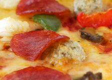 Close-up photo of delicious pizza background Royalty Free Stock Images