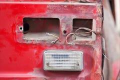 Close-up photo of empty backlight slot car. Close-up photo backlight of red rusty car Stock Photos