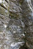 A close up photo of etched symbols on a limestone wall. Near Minneopa Falls in Minnesota Stock Photography