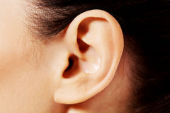 Close up photo of a female ear Royalty Free Stock Photo