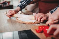 Close up photo of female hands kneading pizza dough at home kitc stock image