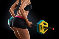 Close up photo of fitness woman workout with barbell at gym stock images