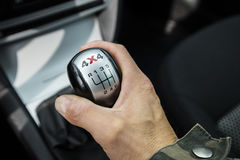 Close-up photo of four-wheel drive vehicle shifter. Close-up photo of four-wheel drive vehicle shifter in Finland. The photograph is also a man's hand changing Stock Photography