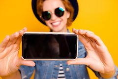 Close up photo foxy she her lady modern look telephone make take selfies speak tell skype wear specs vintage hat casual. Striped t-shirt jacket jeans denim royalty free stock images