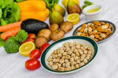 Close up photo of fresh fruit and vegetables, grains, and nuts on a white background. Royalty Free Stock Photo