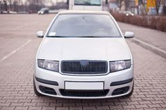 Close-up photo of front part the silver car.  royalty free stock images