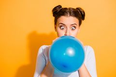 Close up photo of funky childish cheerful lady impressed by size of ballon for festivals carnivals celebration. Anniversary. Dressed in white cotton outfit royalty free stock photos