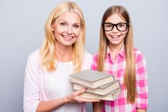 Close up photo funny blond hair she her grandma support little granddaughter hold read books ready studying year wear royalty free stock image