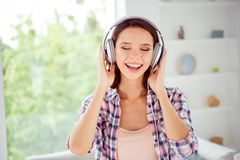 Close up photo funny funky cute student head phone sound track hear single rock close eyes rejoice content positive royalty free stock photo