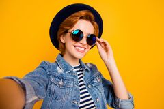 Close up photo funny funky foxy she her lady make take selfies speak skype parents friends wear specs vintage hat casual. Striped t-shirt jacket jeans denim royalty free stock photos