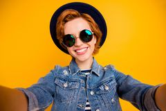 Close up photo funny funky foxy she her lady make take selfies speak tell skype friends wear specs vintage hat casual. Striped t-shirt jacket jeans denim royalty free stock photo