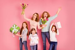 Close up photo ginger foxy little girls mom granny visit party bring bouquet big gift boxes visit party yeah screaming stock image
