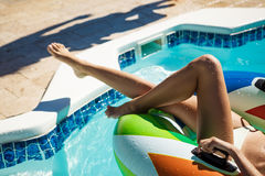 Close up photo of girl`s legs in swimming pool. Stock Photo