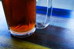 Close up photo of glass of black tea. Fresh drink Royalty Free Stock Photography